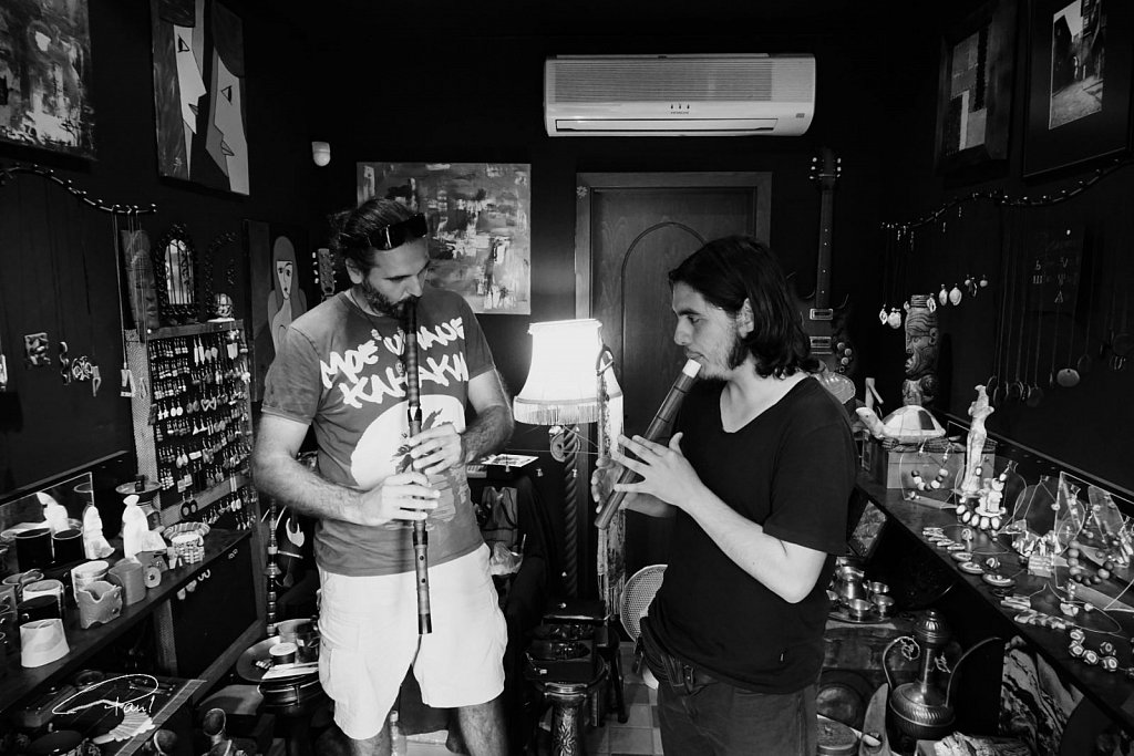 Flute players in a shop